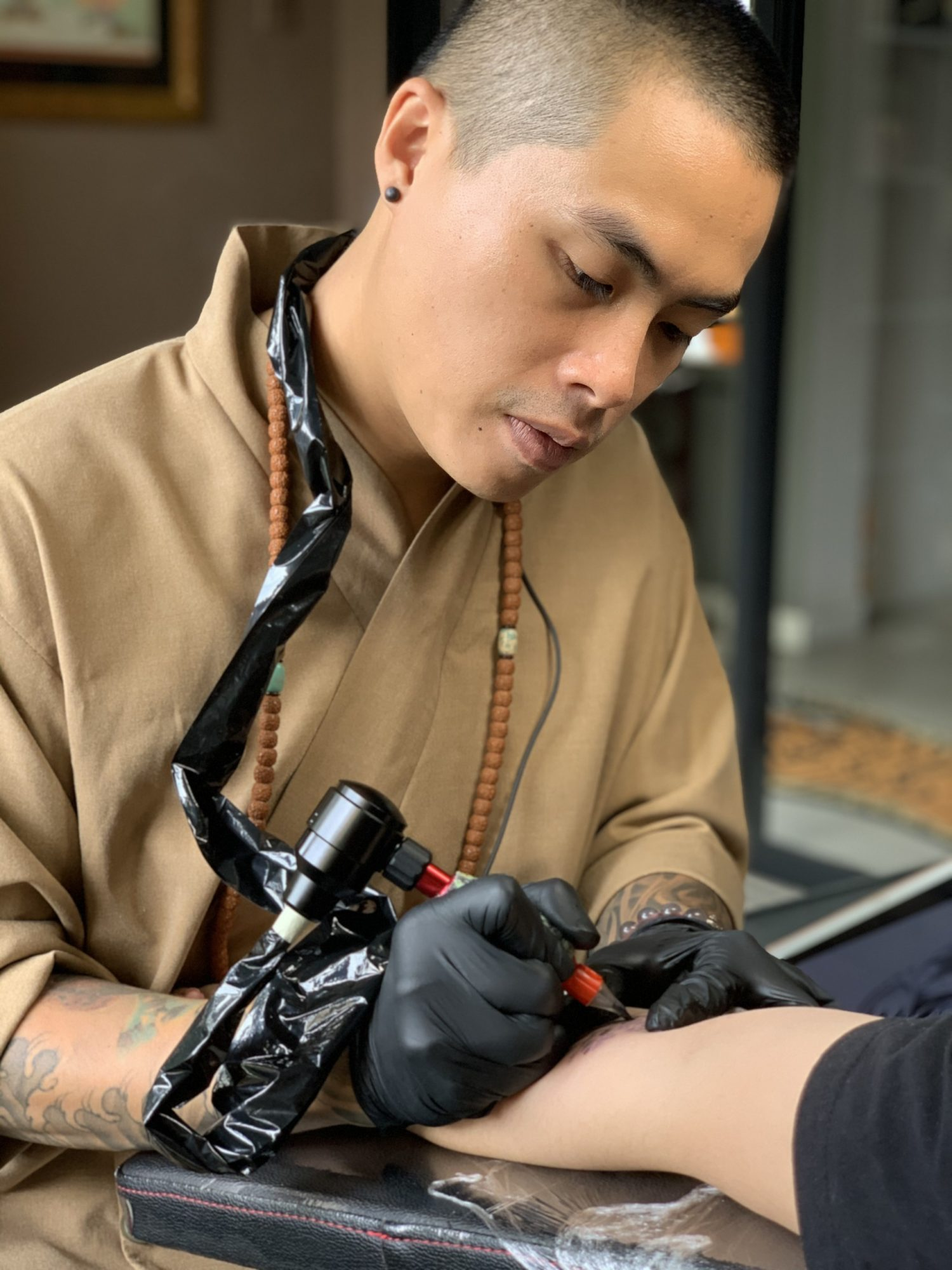 Tattoo Artist Bo Toee